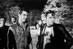2008.099.010 B & W photo on set of The Outsiders; from right: Emilio Estevez, Patrick Swayze (behind Estevez) and Tom Cruise. 1982. Photo by Dave Kraus/Tulsa Tribune.